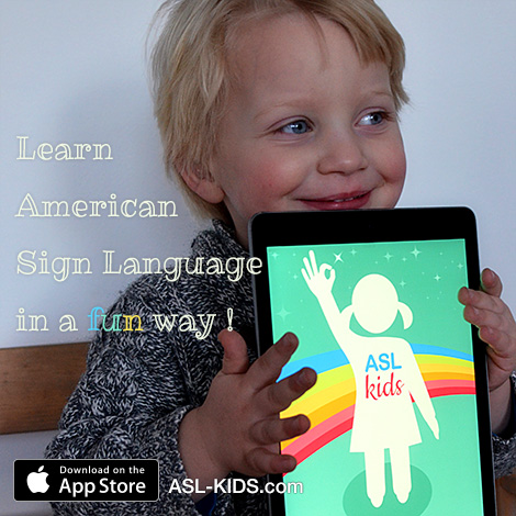 Boy holding an iPad with the sign language app
